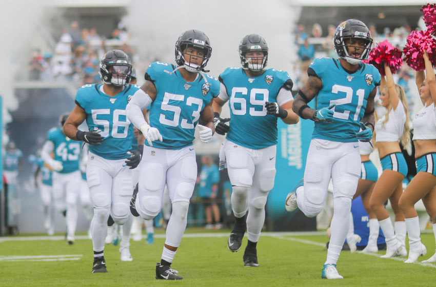 JACKSONVILLE, FLORIDA - OCTOBER 27: A.J. Bouye #21 of the Jacksonville Jaguars enters the field with teammates Tyler Shatley #69 and Malcolm Smith #53 before the start of a game against the New York Jets at TIAA Bank Field on October 27, 2019 in Jacksonville, Florida. (Photo by James Gilbert/Getty Images)