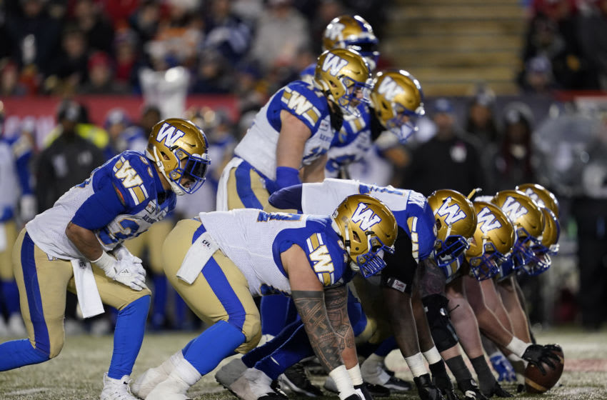 CALGARY, AB - NOVEMBER 24: The Winnipeg Blue Bombers offensive line sets up against the Hamilton Tiger-Cats at McMahon Stadium on November 24, 2019 in Calgary, Canada. Winnipeg Blue Bombers defeated the Hamilton Tiger-Cats 33-12 in the 107th Grey Cup. (Photo by John E. Sokolowski/Getty Images)