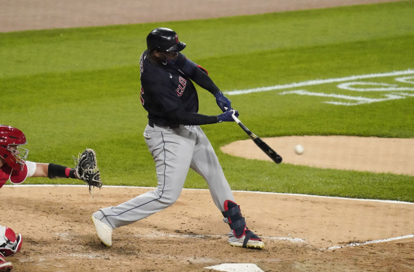CHICAGO, ILLINOIS - AUGUST 09: Franmil Reyes #32 of the Cleveland Indians hits an RBI double during the eighth inning of a game against the Chicago White Sox on August 09, 2020 in Chicago, Illinois. (Photo by Nuccio DiNuzzo/Getty Images)