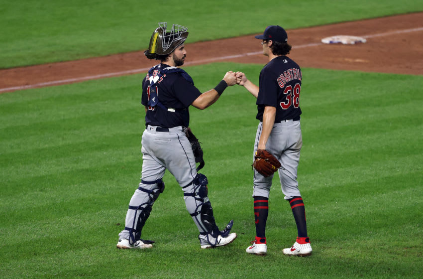 KANSAS CITY, MISSOURI - SEPTEMBER 01: Pitcher Cal Quantrill #38 of the Cleveland Indians is congratulated by catcher Austin Hedges #17 after the Indians defeated the Kansas City Royals 10-1 to win the game at Kauffman Stadium on September 01, 2020 in Kansas City, Missouri. (Photo by Jamie Squire/Getty Images)