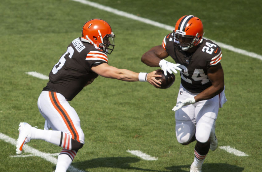 Sep 27, 2020; Cleveland, Ohio, USA; Cleveland Browns quarterback Baker Mayfield (6) hands the ball off to running back Nick Chubb (24) during the first quarter against the Washington Football Team at FirstEnergy Stadium. Mandatory Credit: Scott Galvin-USA TODAY Sports