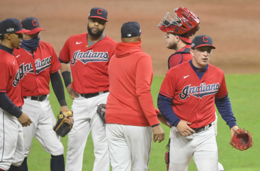 Sep 30, 2020; Cleveland, Ohio, USA; Cleveland Indians relief pitcher James Karinchak (99), right, reacts as he walks off the mound during a pitching change in the fourth inning against the New York Yankees at Progressive Field. Mandatory Credit: David Richard-USA TODAY Sports