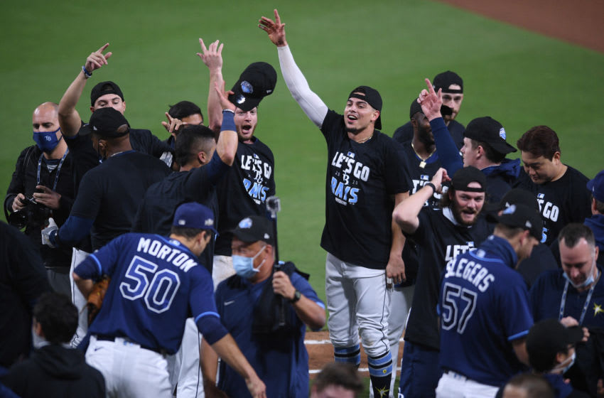 Oct 9, 2020; San Diego, California, USA; Members of the Tampa Bay Rays celebrate after defeating the New York Yankees in game five of the 2020 ALDS at Petco Park. Mandatory Credit: Orlando Ramirez-USA TODAY Sports