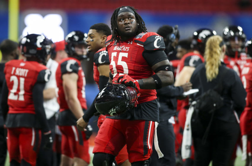 Jan 1, 2021; Atlanta, GA, USA; Cincinnati Bearcats offensive lineman James Hudson (55) shows emotion after being ejected for targeting against the Georgia Bulldogs in the second quarter of the Chick-fil-A Peach Bowl at Mercedes-Benz Stadium. Mandatory Credit: Brett Davis-USA TODAY Sports