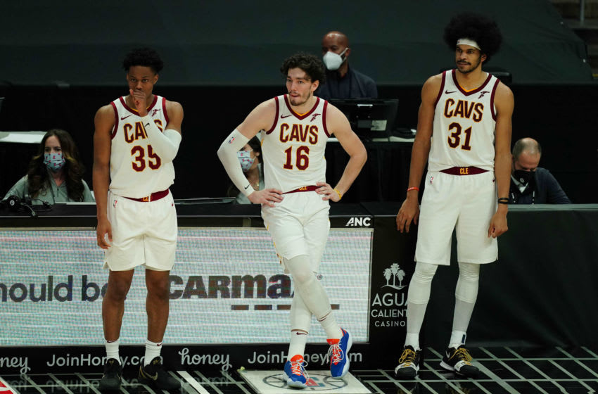 Feb 14, 2021; Los Angeles, California, USA; Cleveland Cavaliers guard Isaac Okoro (35), forward Cedi Osman (16) and center Jarrett Allen (31) watch from the bench against the LA Clippers in the second half at Staples Center. The Clippers defeated the Cavaliers 128-111. Mandatory Credit: Kirby Lee-USA TODAY Sports