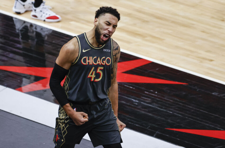 Mar 14, 2021; Chicago, Illinois, USA; Chicago Bulls guard Denzel Valentine (45) reacts after scoring against the Toronto Raptors during the second half of an NBA game at United Center. Mandatory Credit: Kamil Krzaczynski-USA TODAY Sports