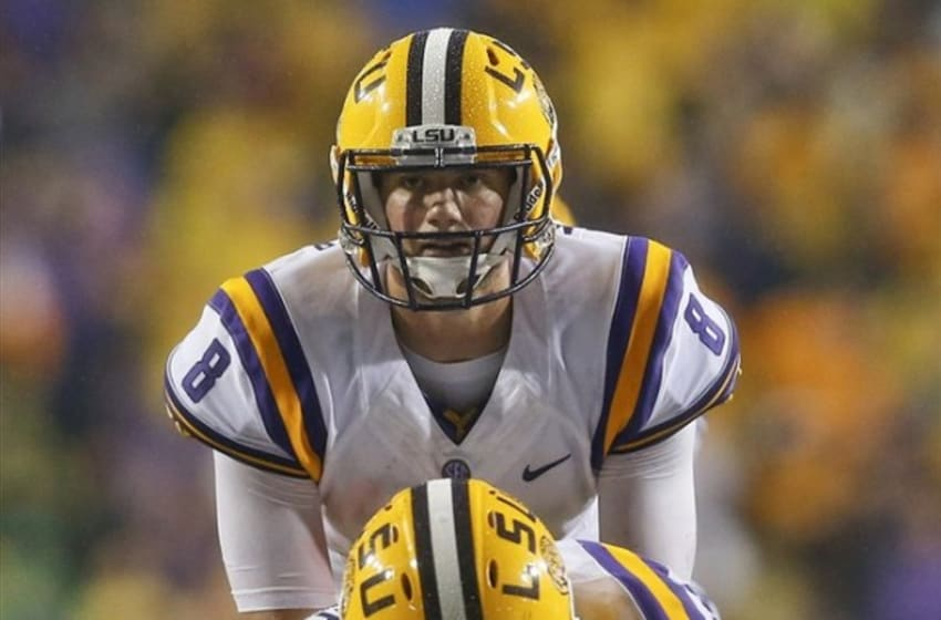 Sep 21, 2013; Baton Rouge, LA, USA; LSU Tigers quarterback Zach Mettenberger (8) under center against the Auburn Tigers during the first quarter of a game at Tiger Stadium. Mandatory Credit: Derick E. Hingle-USA TODAY Sports