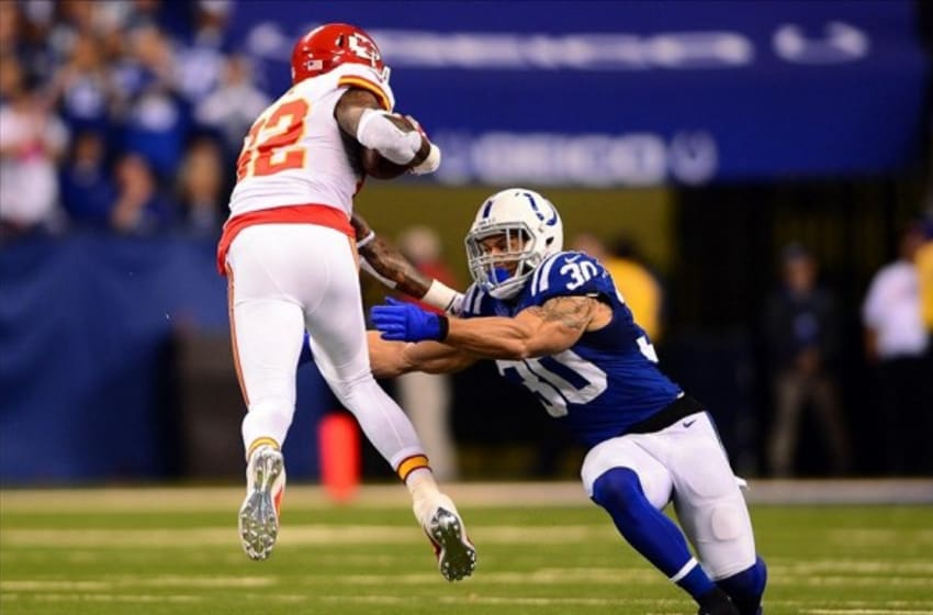 Jan 4, 2014; Indianapolis, IN, USA; Kansas City Chiefs wide receiver Dwayne Bowe (82) gets away from Indianapolis Colts strong safety LaRon Landry (30) during the first quarter of the 2013 AFC wild card playoff football game at Lucas Oil Stadium. Mandatory Credit: Andrew Weber-USA TODAY Sports