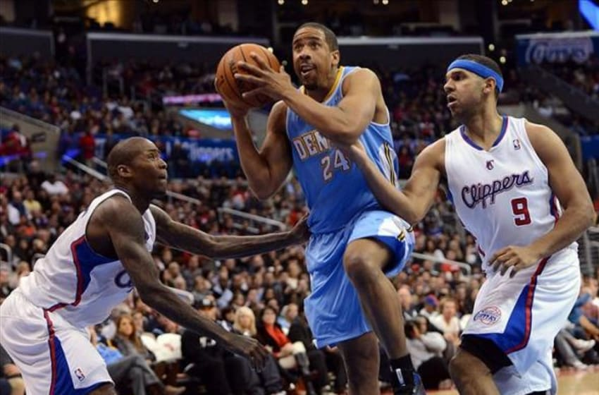 Dec 21, 2013; Los Angeles, CA, USA; Denver Nuggets point guard Andre Miller (24) drives the lane past Los Angeles Clippers shooting guard Jamal Crawford (11) and small forward Jared Dudley (9) in the first half of the game at Staples Center. Mandatory Credit: Jayne Kamin-Oncea-USA TODAY Sports