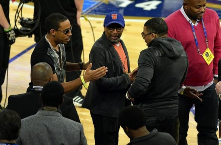 Feb 15, 2014; New Orleans, LA, USA; Hip-shop artists Ludacris and Nelly talk with Film director Spike Lee at Smoothie King Center. Mandatory Credit: Bob Donnan-USA TODAY Sports