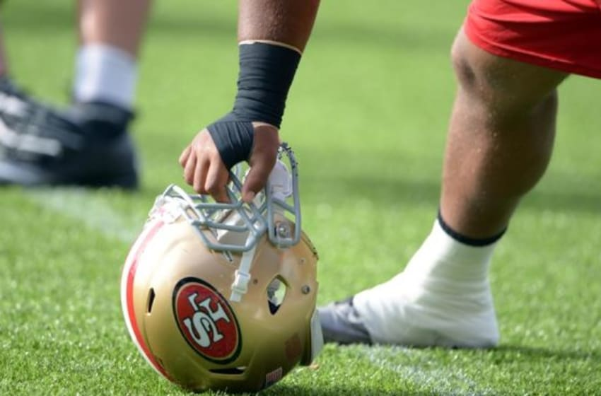 Oct 25, 2013; London, United Kingdom, USA; General view of San Francisco 49ers guard Joe Looney holding a helmet at practice at Allianz Park Stadium in advance of the NFL International Series game against the Jacksonville Jaguars. Mandatory Credit: Kirby Lee-USA TODAY Sports