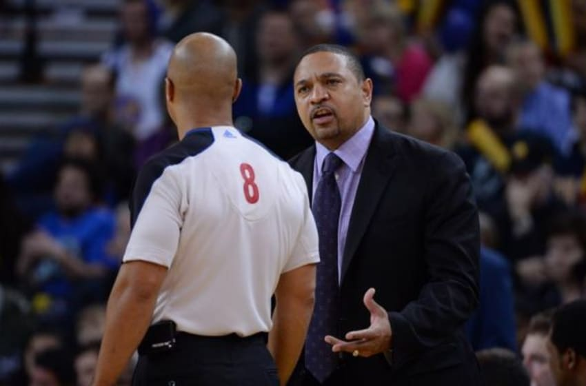December 21, 2013; Oakland, CA, USA; Golden State Warriors head coach Mark Jackson (right) argues with NBA referee Marc Davis (8) during the third quarter against the Los Angeles Lakers at Oracle Arena. The Warriors defeated the Lakers 102-83. Mandatory Credit: Kyle Terada-USA TODAY Sports