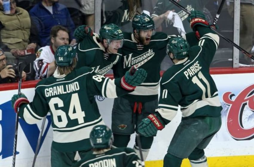 May 9, 2014; Saint Paul, MN, USA; Minnesota Wild forward Jason Pominville (29) celebrates his goal with teammates during the second period against the Chicago Blackhawks in game four of the second round of the 2014 Stanley Cup Playoffs at Xcel Energy Center. Mandatory Credit: Brace Hemmelgarn-USA TODAY Sports