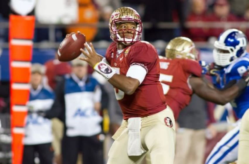 Dec 7, 2013; Charlotte, NC, USA; Florida State Seminoles quarterback Jameis Winston (5) throws a pass during the second quarter against the Duke Blue Devils at Bank of America Stadium. Mandatory Credit: Jeremy Brevard-USA TODAY Sports