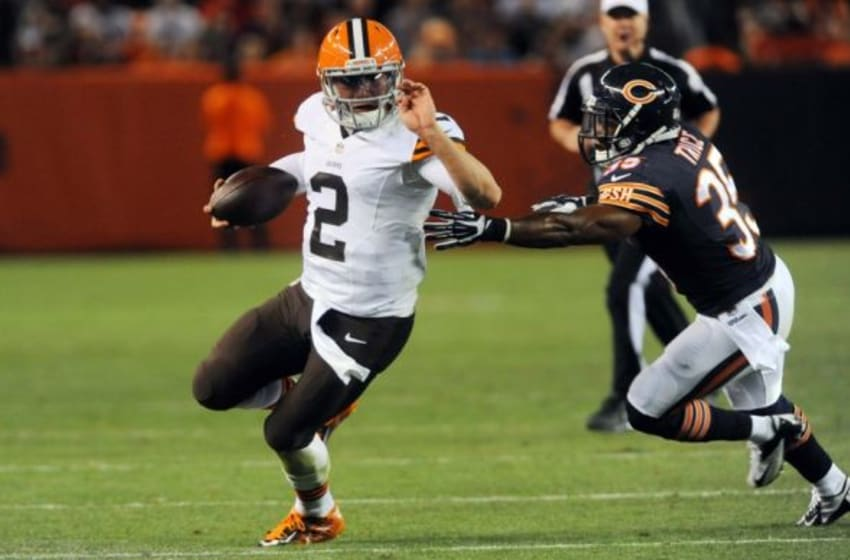 Aug 28, 2014; Cleveland, OH, USA; Cleveland Browns quarterback Johnny Manziel (2) runs from Chicago Bears safety Marcus Trice during the third quarter at FirstEnergy Stadium. Mandatory Credit: Ken Blaze-USA TODAY Sports