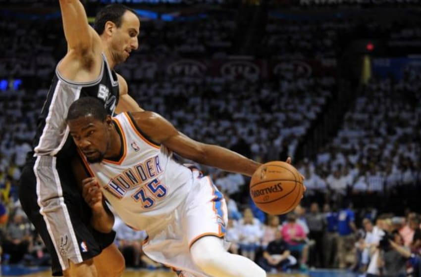 May 31, 2014; Oklahoma City, OK, USA; Oklahoma City Thunder forward Kevin Durant (35) handles the ball against San Antonio Spurs guard Manu Ginobili (20) during the first quarter in game six of the Western Conference Finals of the 2014 NBA Playoffs at Chesapeake Energy Arena. Mandatory Credit: Mark D. Smith-USA TODAY Sports