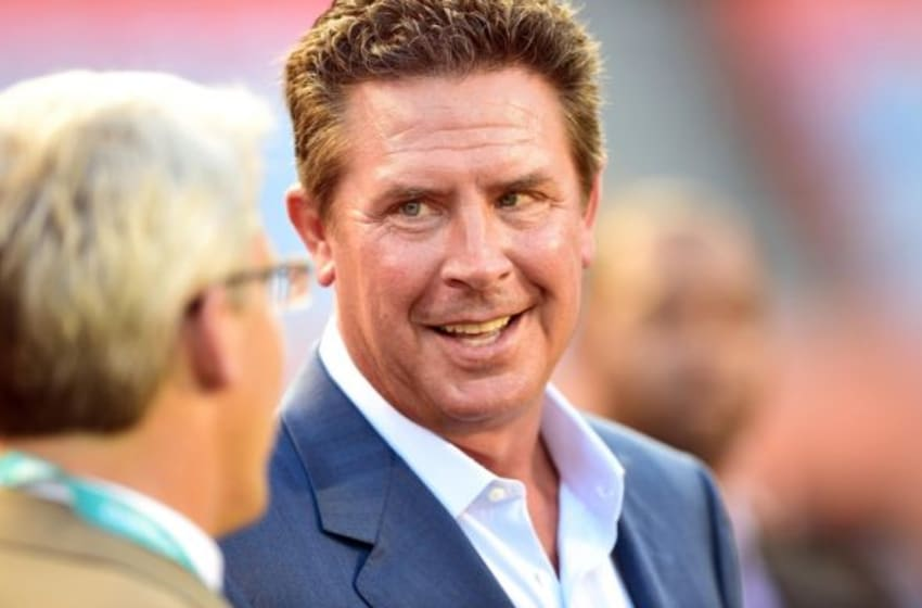 Aug 28, 2014; Miami Gardens, FL, USA; Miami Dolphins former quarterback Dan Marino talks with general manager Dennis Hickey prior to the game against St. Louis Rams at Sun Life Stadium. Mandatory Credit: Brad Barr-USA TODAY Sports