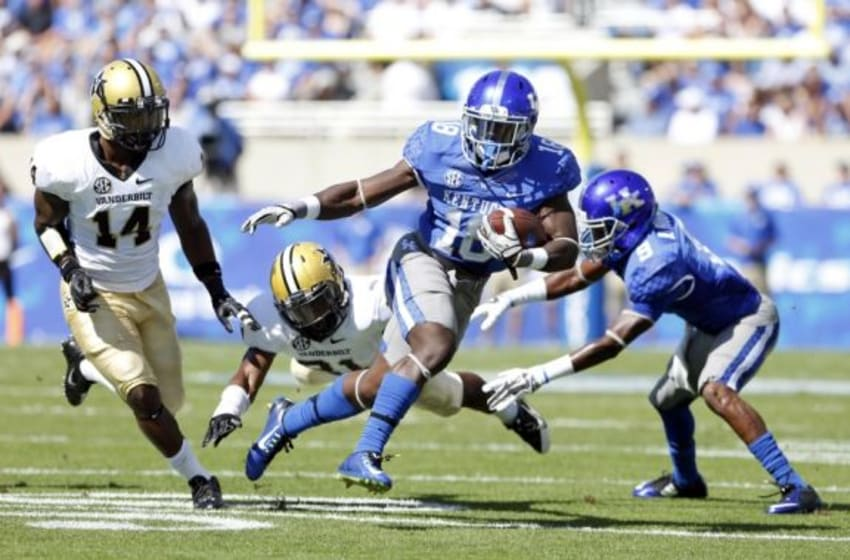 Sep 27, 2014; Lexington, KY, USA; Kentucky Wildcats running back Stanley Williams (18) runs the ball against the Vanderbilt Commodores in the first half at Commonwealth Stadium. Mandatory Credit: Mark Zerof-USA TODAY Sports