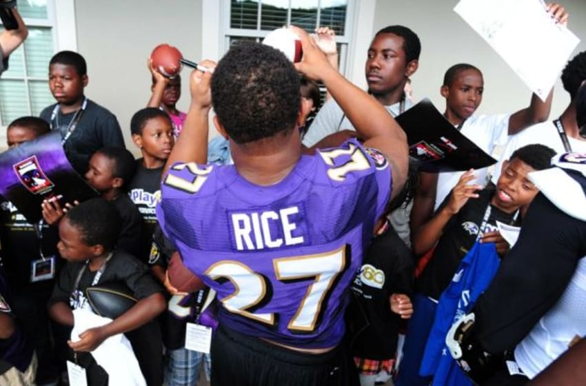 Jul 25, 2013; Owings Mills, MD, USA; Baltimore Ravens running back Ray Rice (27) signs autographs for fans after training camp at the Under Armour Performance Center. Mandatory Credit: Evan Habeeb-USA TODAY Sports