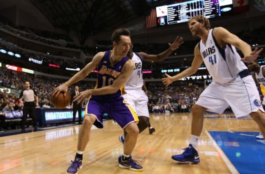 Feb 24, 2013; Dallas, TX, USA; Los Angeles Lakers guard Steve Nash (10) passes the ball behind his back against Dallas Mavericks forward Dirk Nowitzki (41) at the American Airlines Center. The Lakers beat the Mavs 103-99. Mandatory Credit: Matthew Emmons-USA TODAY Sports