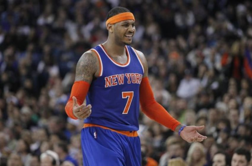 Dec 27, 2014; Sacramento, CA, USA; New York Knicks forward Carmelo Anthony (7) reacts after being called for a foul against the Sacramento Kings in the third quarter at Sleep Train Arena. The Kings won 135-129 in overtime. Mandatory Credit: Cary Edmondson-USA TODAY Sports