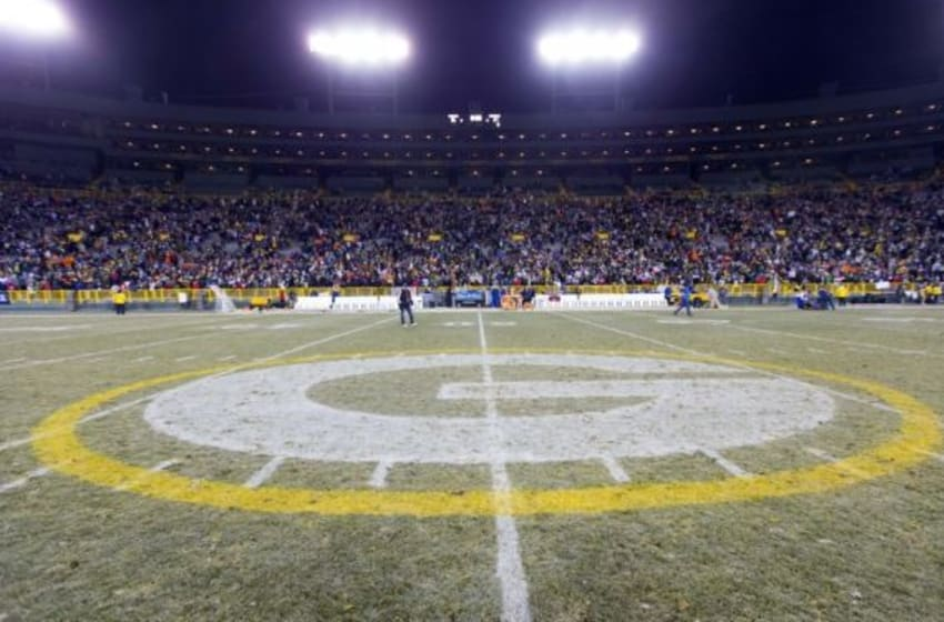Nov 30, 2014; Green Bay, WI, USA; The Green Bay Packers logo at midfield of Lambeau Field following the game between the New England Patriots and Green Bay Packers. Green Bay won 26-21. Mandatory Credit: Jeff Hanisch-USA TODAY Sports