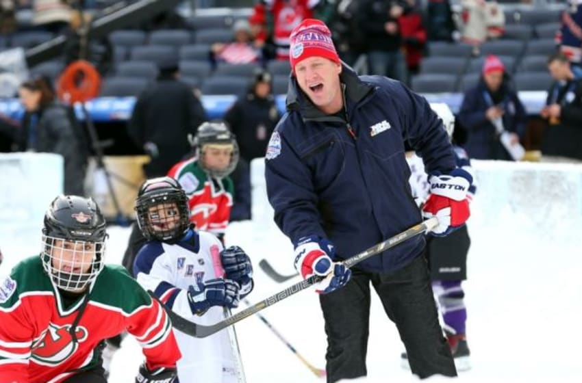 Jan 26, 2014; New York City, NY, USA; NHL former player Jeremy Roenick skates with youngsters on a miniature rink before the Stadium Series hockey game between the New Jersey Devils and the New York Rangers at Yankee Stadium. Mandatory Credit: Ed Mulholland-USA TODAY Sports