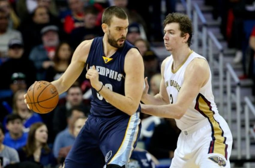 Jan 9, 2015; New Orleans, LA, USA; Memphis Grizzlies center Marc Gasol (33) against New Orleans Pelicans center Omer Asik (3) during the second quarter of a game at the Smoothie King Center. Mandatory Credit: Derick E. Hingle-USA TODAY Sports