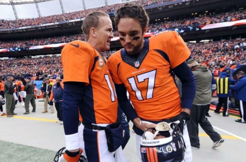 Nov 23, 2014; Denver, CO, USA; Denver Broncos quarterback Peyton Manning (18) and Denver Broncos quarterback Brock Osweiler (17) talk before the game against the Miami Dolphins. The Broncos defeated the Dolphins 39-36. Mandatory Credit: Ron Chenoy-USA TODAY Sports