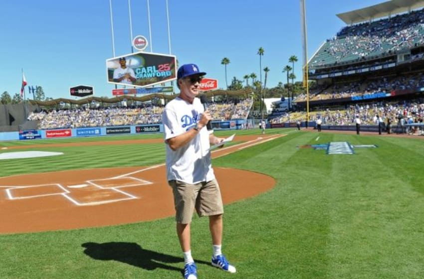 October 16, 2013; Los Angeles, CA, USA; Film actor Will Ferrell reads the starting lineup for the Los Angeles Dodgers game five of the National League Championship Series baseball game against the St. Louis Cardinals at Dodger Stadium. Mandatory Credit: Jayne Kamin-Oncea-USA TODAY Sports