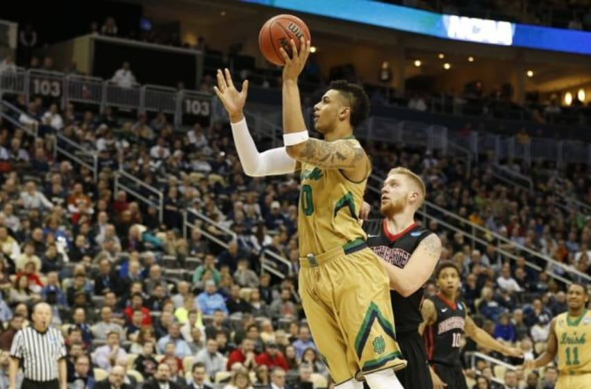 Mar 19, 2015; Pittsburgh, PA, USA; Notre Dame Fighting Irish forward Zach Auguste (30) shoots the ball in front of Northeastern Huskies guard Zach Stahl (33) during the second half in the second round of the 2015 NCAA Tournament at Consol Energy Center. The Fighting Irish won 69-65. Mandatory Credit: Geoff Burke-USA TODAY Sports