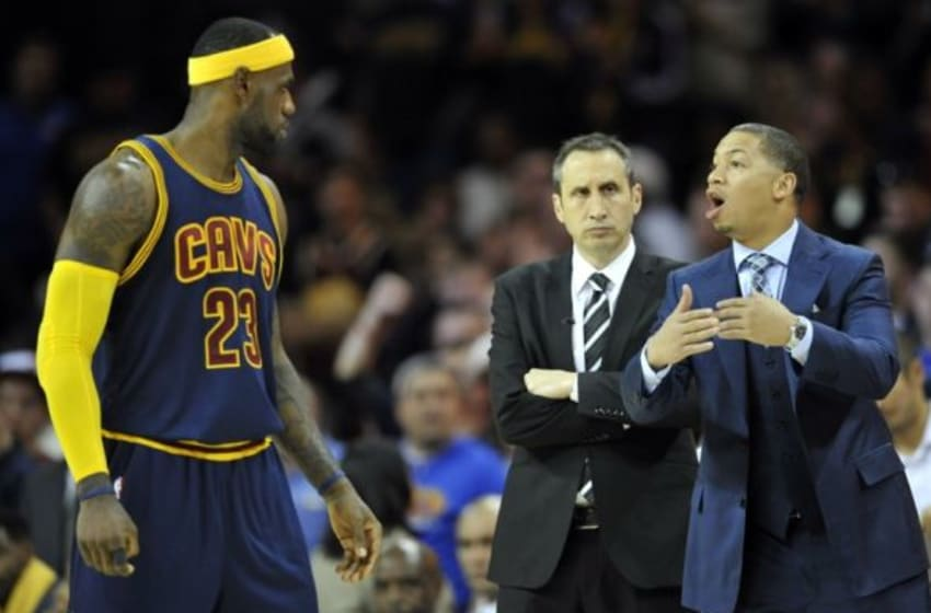 Oct 30, 2014; Cleveland, OH, USA; Cleveland Cavaliers head coach David Blatt (center) and assistant coach Tyronn Lue (right) stand near forward LeBron James (23) against the New York Knicks at Quicken Loans Arena. New York won 95-90. Mandatory Credit: David Richard-USA TODAY Sports