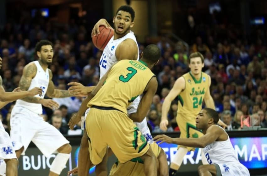 Mar 28, 2015; Cleveland, OH, USA; Kentucky Wildcats forward Karl-Anthony Towns (12) brings up the ball after a scramble as Notre Dame Fighting Irish forward V.J. Beachem (3) looks on during the first half in the finals of the midwest regional of the 2015 NCAA Tournament at Quicken Loans Arena. Mandatory Credit: Andrew Weber-USA TODAY Sports