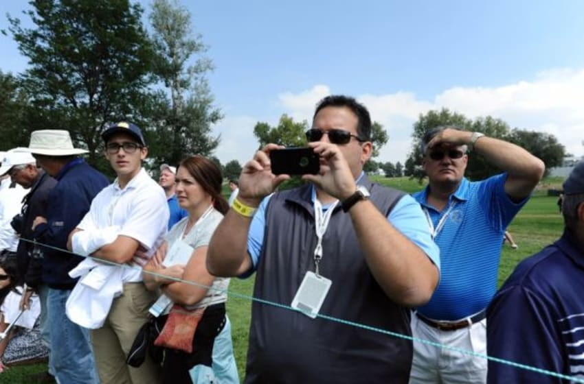Sep 6, 2014; Cherry Hills Village, CO, USA; General view of fan in the gallery using a smart phone to take a photo during the third round of the BMW Championship at Cherry Hills Country Club. Mandatory Credit: Ron Chenoy-USA TODAY Sports