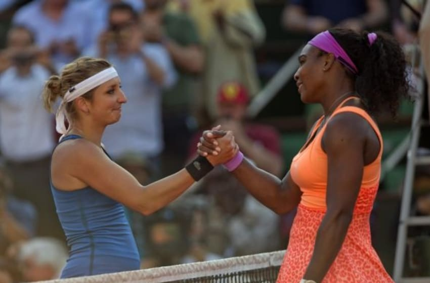 Jun4, 2015; Paris, France; Serena Williams (USA), right, at the net with Timea Bacsinszky (SUI) after their match on day 12 of the 2015 French Open at Roland Garros. Mandatory Credit: Susan Mullane-USA TODAY Sports