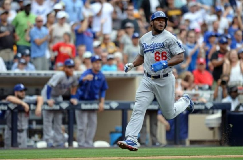 Jun 14, 2015; San Diego, CA, USA; Los Angeles Dodgers right fielder Yasiel Puig (66) scores on a double by first baseman Adrian Gonzalez (not pictured) during the eighth inning against the San Diego Padres at Petco Park. Mandatory Credit: Jake Roth-USA TODAY Sports