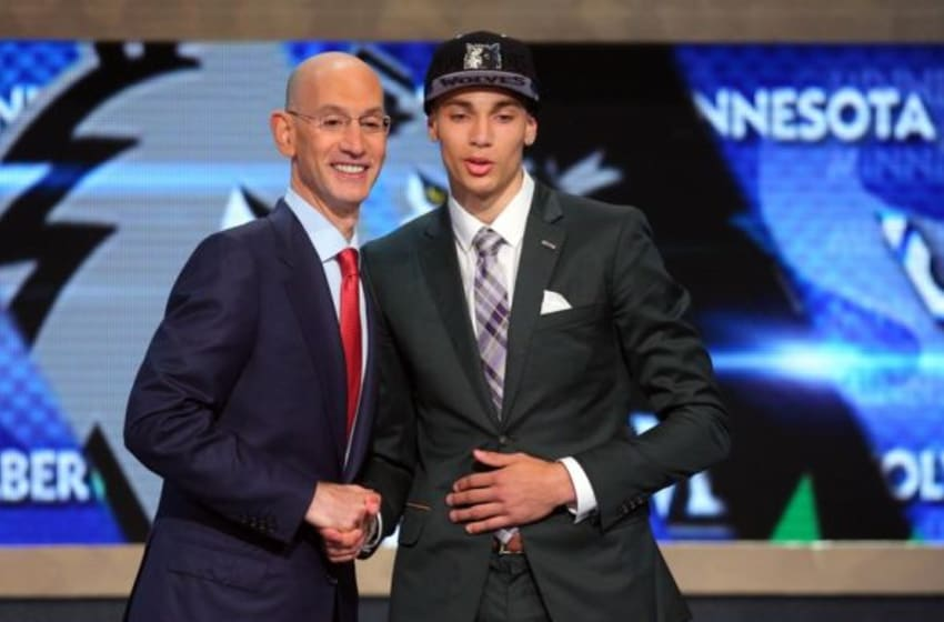 Jun 26, 2014; Brooklyn, NY, USA; Zach LaVine (UCLA) shakes hands with NBA commissioner Adam Silver after being selected as the number thirteen overall pick to the Minnesota Timberwolves in the 2014 NBA Draft at the Barclays Center. Mandatory Credit: Brad Penner-USA TODAY Sports