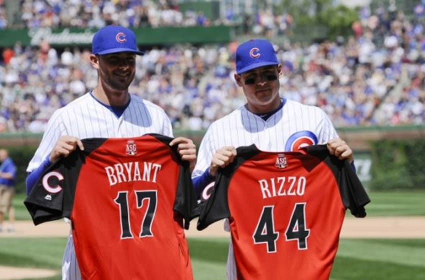 Jul 10, 2015; Chicago, IL, USA; Chicago Cubs third baseman Kris Bryant (17) and first baseman Anthony Rizzo (44) show off their All Star game jerseys before their game against the Chicago White Sox at Wrigley Field. Mandatory Credit: Matt Marton-USA TODAY Sports