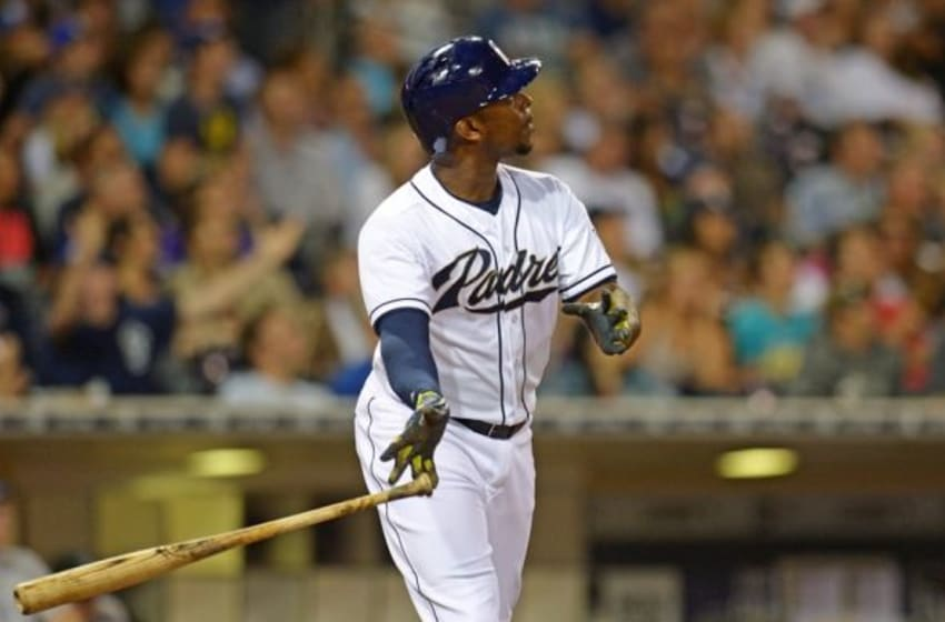 Jul 17, 2015; San Diego, CA, USA; San Diego Padres left fielder Justin Upton (10) watches the flight of his eighth inning home run against the Colorado Rockies at Petco Park. Mandatory Credit: Jake Roth-USA TODAY Sports