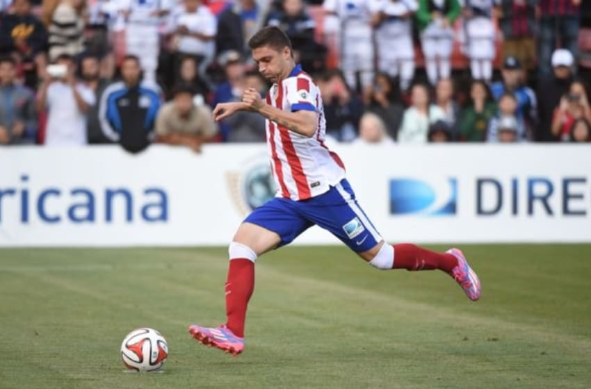 July 27, 2014; San Francisco, CA, USA; Atletico Madrid player Guillherme Siqueira (3) kicks the ball during a shootout against the San Jose Earthquakes at Candlestick Park. Atletico Madrid defeated the Earthquakes 4-3 in a shootout. Mandatory Credit: Kyle Terada-USA TODAY Sports