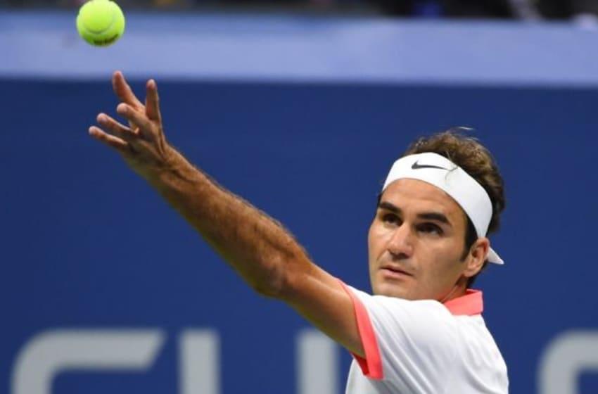 Sep 13, 2015; New York, NY, USA; Roger Federer of Switzerland serves to Novak Djokovic of Serbia in the men