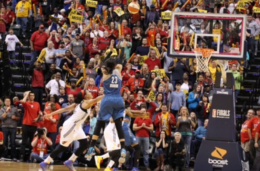 Oct 9, 2015; Indianapolis, IN, USA; Minnesota Lynx forward Maya Moore (23) makes a game winning three point shot with .1 of a second against the Indiana Fever during game three of the WNBA Finals at Bankers Life Fieldhouse. Minnesota defeats Indiana 80-77. Mandatory Credit: Brian Spurlock-USA TODAY Sports
