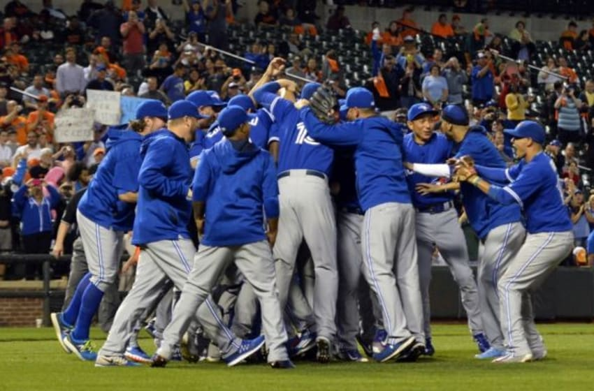 Sep 30, 2015; Baltimore, MD, USA; Toronto Blue Jays celebrate on the field after clinching the A.L East division at Oriole Park at Camden Yards. Toronto Blue Jays defeated Baltimore Orioles 15-2. Mandatory Credit: Tommy Gilligan-USA TODAY Sports