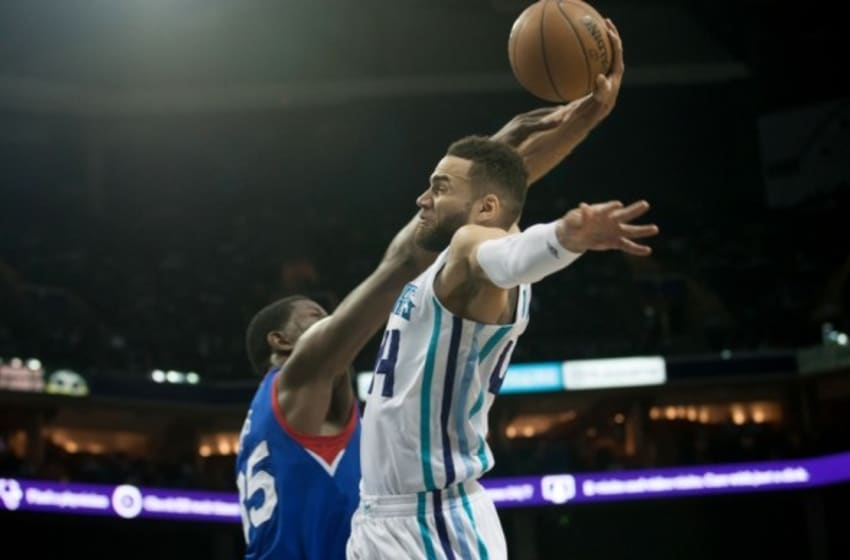 Apr 4, 2015; Charlotte, NC, USA; Charlotte Hornets forward Jeff Taylor (44) is fouled by Philadelphia 76ers center Henry Sims (35) during the second half at Time Warner Cable Arena. Hornets defeated the 76ers 92-91. Mandatory Credit: Jeremy Brevard-USA TODAY Sports