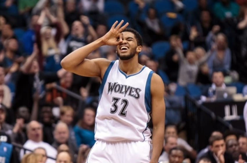 Oct 23, 2015; Minneapolis, MN, USA; Minnesota Timberwolves center Karl-Anthony Towns (32) celebrates his assist on a three pointer in the third quarter against the Milwaukee Bucks at Target Center. The Minnesota Timberwolves beat the Milwaukee Bucks 112-108. Mandatory Credit: Brad Rempel-USA TODAY Sports
