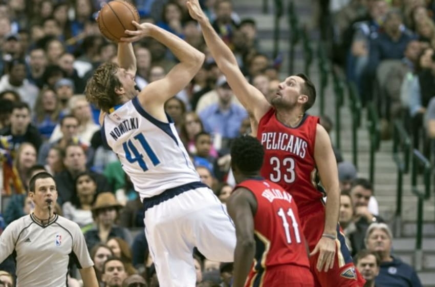 Jan 2, 2016; Dallas, TX, USA; Dallas Mavericks forward Dirk Nowitzki (41) shoots over New Orleans Pelicans forward Ryan Anderson (33) during the second half at the American Airlines Center. The Pelicans defeat the Mavericks 105-98. Mandatory Credit: Jerome Miron-USA TODAY Sports