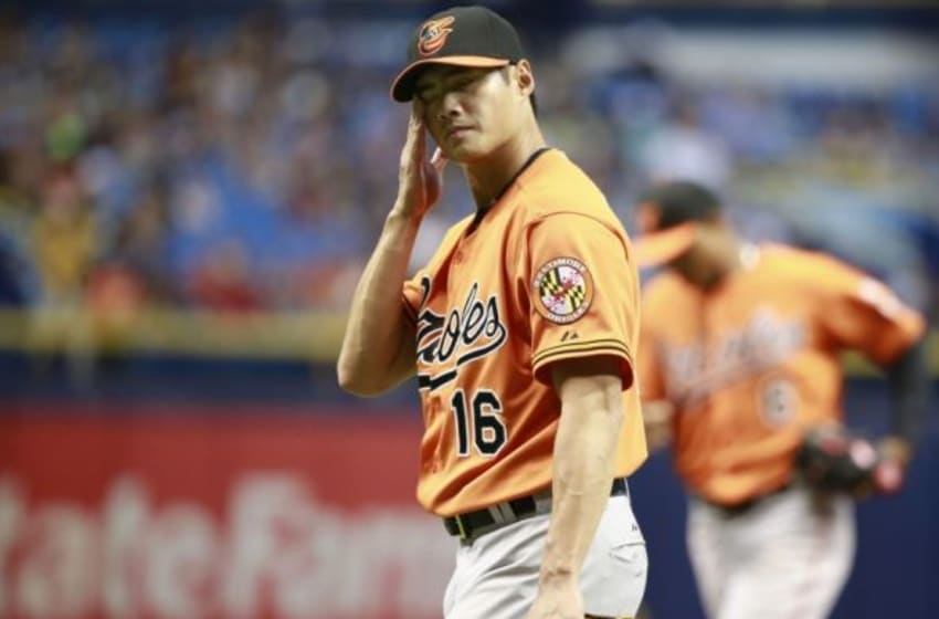 Sep 19, 2015; St. Petersburg, FL, USA; Baltimore Orioles starting pitcher Wei-Yin Chen (16) reacts as he walks back to the dugout at the end of the first inning against the Tampa Bay Rays at Tropicana Field. Mandatory Credit: Kim Klement-USA TODAY Sports