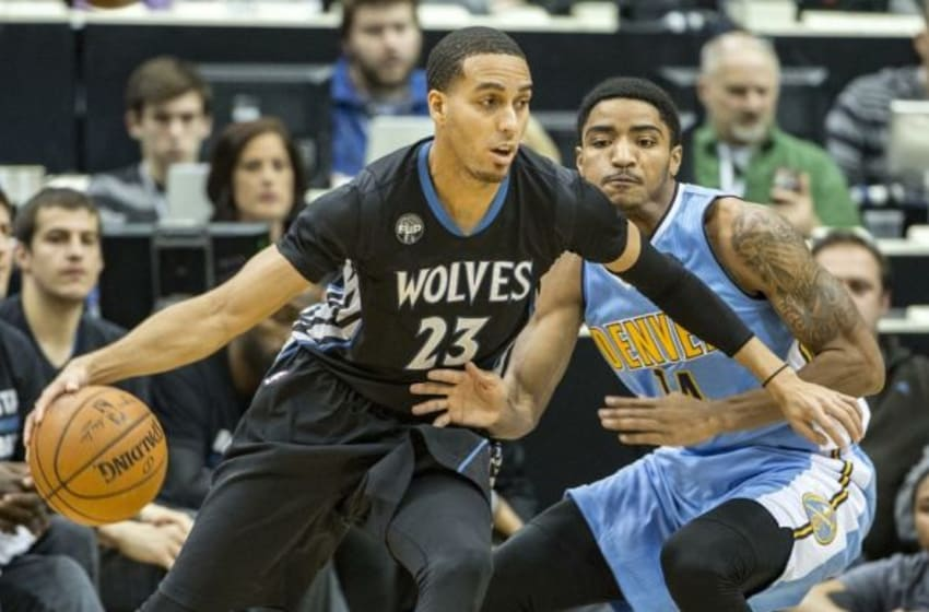 Dec 15, 2015; Minneapolis, MN, USA; Minnesota Timberwolves guard Kevin Martin (23) dribbles the ball around Denver Nuggets guard Gary Harris (14) in the first half at Target Center. Mandatory Credit: Jesse Johnson-USA TODAY Sports