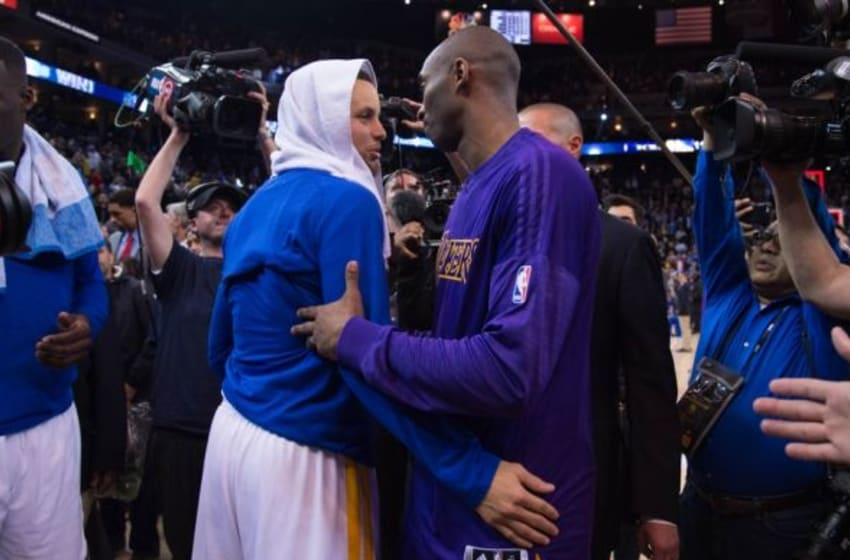 January 14, 2016; Oakland, CA, USA; Golden State Warriors guard Stephen Curry (30, left) shakes hands with Los Angeles Lakers forward Kobe Bryant (24, right) after the game at Oracle Arena. The Warriors defeated the Lakers 116-98. Mandatory Credit: Kyle Terada-USA TODAY Sports