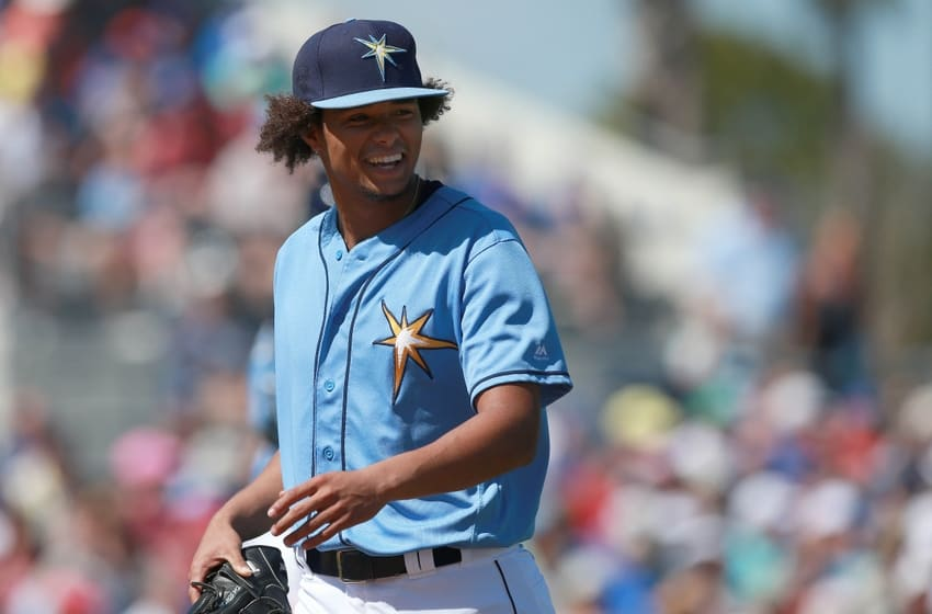 Mar 9, 2016; Port Charlotte, FL, USA; Tampa Bay Rays starting pitcher Chris Archer (22) smiles at the end of the third inning against the Toronto Blue Jays at Charlotte Sports Park. Mandatory Credit: Kim Klement-USA TODAY Sports